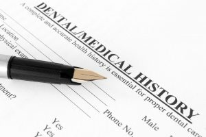 Dental Medical History form with fountain pen.